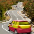 Car on road in colors — Stock Photo