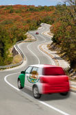 Car on road in national flag of mexico colors — Stock Photo