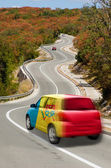 Car on road in national flag of moldova colors — Stock Photo