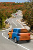 Car on road in national flag of mongolia colors — Stock Photo