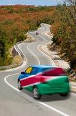 Bil på väg i nationella flagga namibia färger — Stockfoto