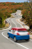 Car on road in national flag of paraguay colors — Stock Photo