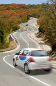 Car on road in national flag of south korea colors — Stock Photo