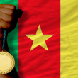 Gold medal for sport and  national flag of cameroon — Stock Photo