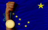 Gold medal for sport and flag of american state of alaska — Stock Photo