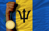 Gold medal for sport and national flag of barbados — Stock Photo