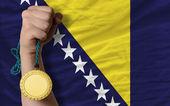 Gold medal for sport and national flag of bosnia herzegovina — Stock Photo
