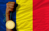 Gold medal for sport and national flag of of chad — Stock Photo