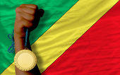 Gold medal for sport and national flag of of congo — Stock Photo