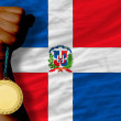 Gold medal for sport and national flag of dominican — Stock Photo #27506249