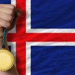 Gold medal for sport and  national flag of iceland    — Stock Photo