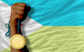Gold medal for sport and national flag of of djibuti — Stock Photo
