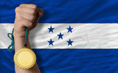 Gold medal for sport and national flag of honduras — Stock Photo