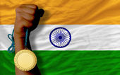 Gold medal for sport and national flag of of india — Stock Photo