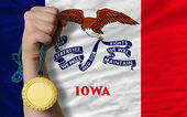 Gold medal for sport and flag of american state of iowa — Stock Photo