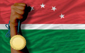Gold medal for sport and national flag of of maghreb — Stock Photo