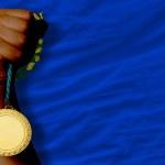 Medalla de oro para el deporte y la bandera del estado norteamericano de nevada — Foto de Stock