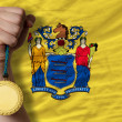 Gold medal for sport and  flag of american state of new jersey — Stock Photo