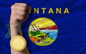 Gold medal for sport and flag of american state of montana — Stock Photo