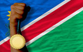Gold medal for sport and national flag of namibia — Stock Photo