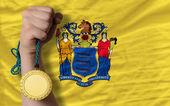 Золотая медаль для спорта и флаг американских штата Нью-Джерси — Стоковое фото