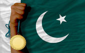 Gold medal for sport and national flag of pakistan — Stock Photo