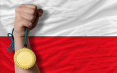 Gold medal for sport and national flag of poland — Stock Photo