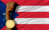 Gold medal for sport and national flag of puertorico — Stock Photo