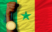 Gold medal for sport and national flag of senegal — Stock Photo