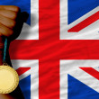 Gold medal for sport and national flag of united kingdom — Stock fotografie #27542725