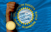 Gold medal for sport and national flag of south dakota — Stock Photo