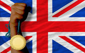 Gold medal for sport and national flag of united kingdom — Stock Photo