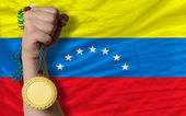 Gold medal for sport and national flag of venezuela — Stock Photo