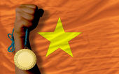 Gold medal for sport and national flag of vietnam — Stock Photo
