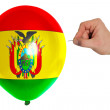 Bursting balloon colored in national flag of bolivia — Stock Photo