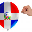 Bursting balloon colored in national flag of dominican — Stock Photo #27683017