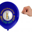 Bursting balloon colored in flag of american state of kentucky — Stock Photo #27683713
