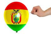 воздушный шар разрывным окрашены в национальный флаг боливии — Стоковое фото