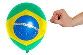 Bursting balloon colored in national flag of brazil — Stock Photo