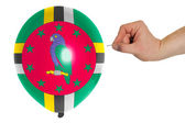 Bursting balloon colored in national flag of dominica — Stock Photo