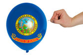 Bursting balloon colored in flag of american state of idaho — Stock Photo