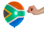Bursting balloon colored in national flag of south africa — Stock Photo
