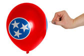 Bursting balloon colored in flag of american state of tennessee — Stock Photo