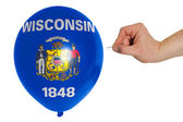 Bursting balloon colored in flag of american state of wisconsin — Stock Photo