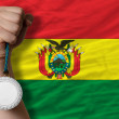 Silver medal for sport and national flag of bolivia — Stock Photo