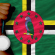 Постер, плакат: Silver medal for sport and national flag of dominica