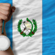 Silver medal for sport and national flag of guatemala — Stok Fotoğraf #27768347