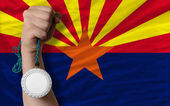 Silver medal for sport and flag of american state of arizona — Stock Photo
