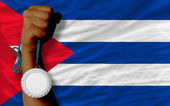 Silver medal for sport and national flag of cuba — Stock Photo