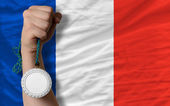 Silver medal for sport and national flag of france — Stock Photo